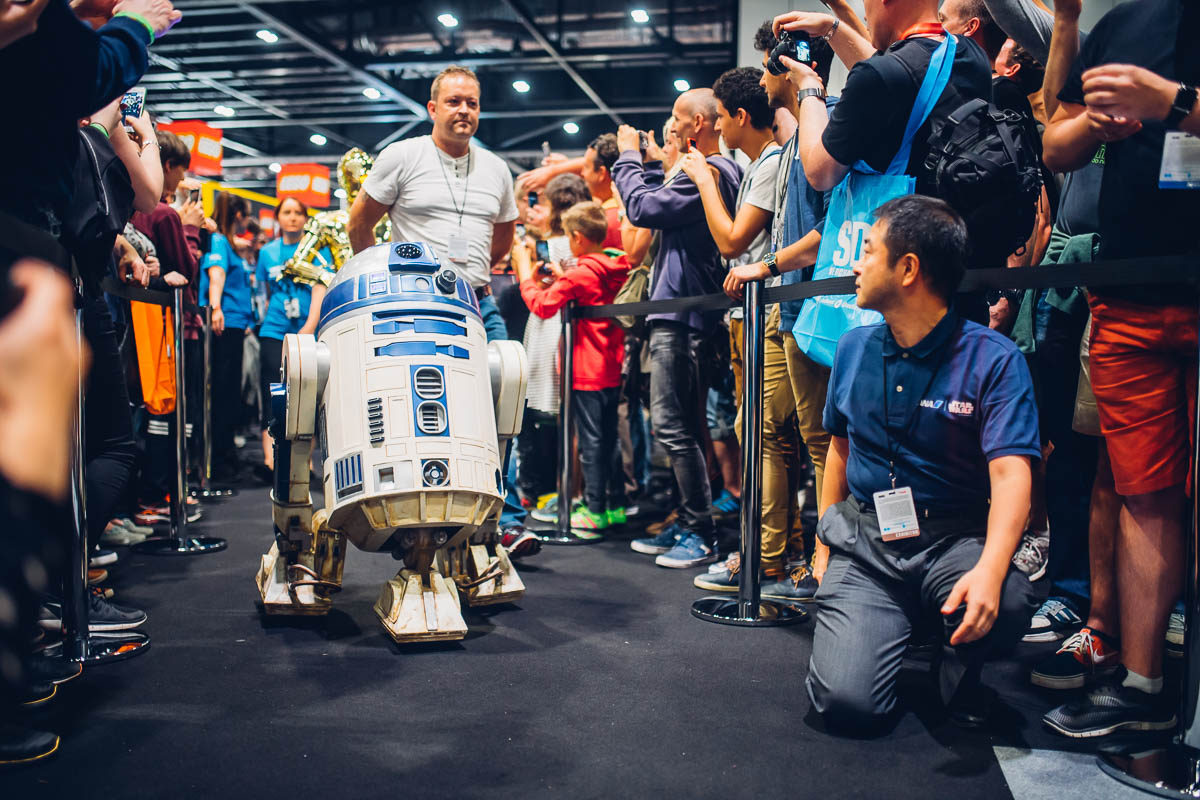 R2-D2 rolls on stage, followed by friends.